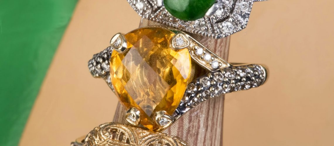 Blue Topaz, yellow citrine and imperial green jade rings.